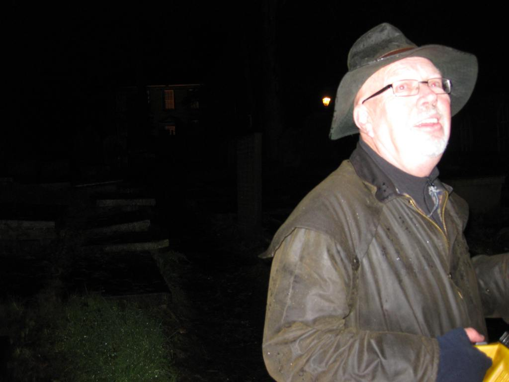 Philip leading a cemetery tour by lantern in Haworth, Yorkshire.