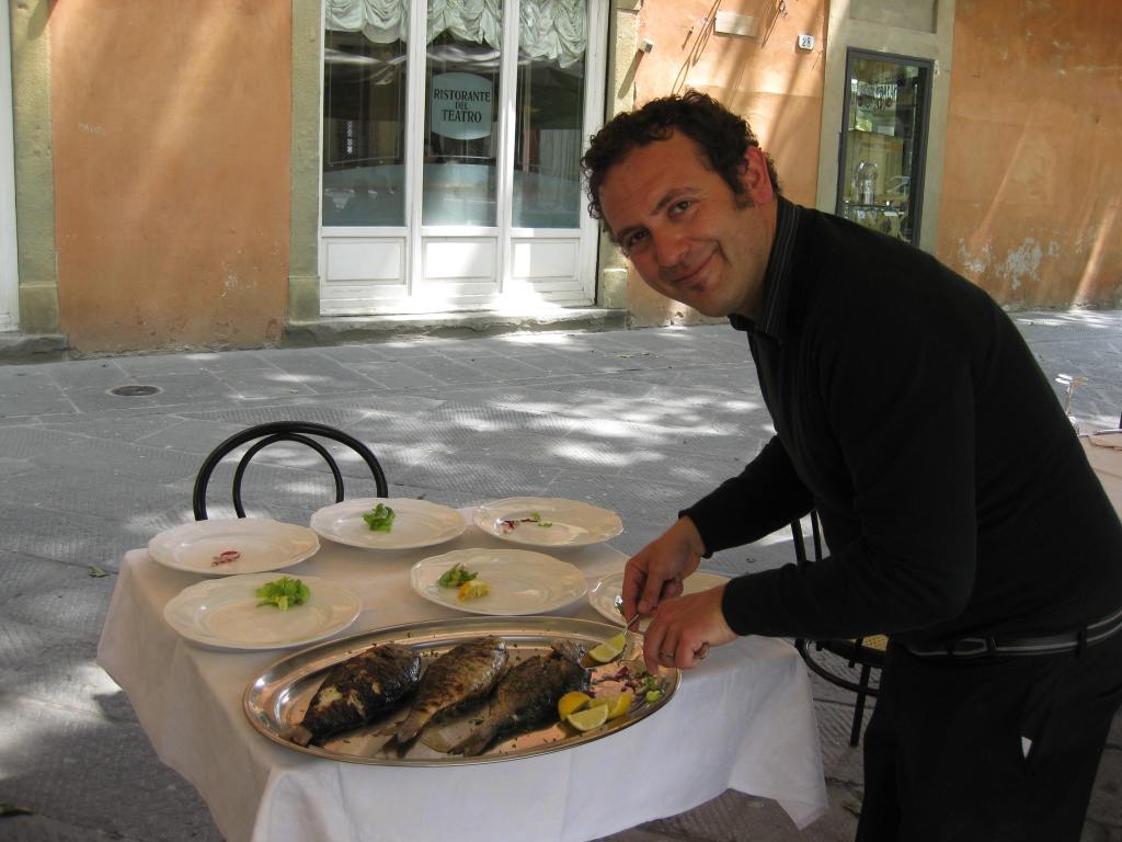 Salvartori serves a fresh fish lunch at Ristorante del Teatro in Lucca, Italy.